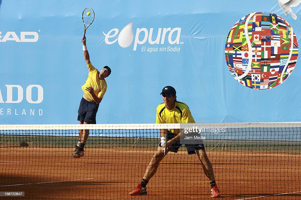Rafael Coutinho y Thomas Tenreiro of Venezuela in action during the Mexican Youth Tennis Open at Deportivo Chapultepec on December 24, 2012 in Mexico City, Mexico.