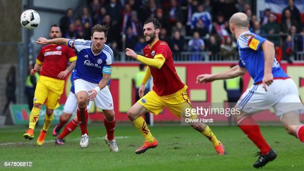 Rafael Czichos of Kiel and Koen van der Biezen of Paderborn compete for the ball during the 3 liga match between Holstein Kiel and SC Paderborn at...