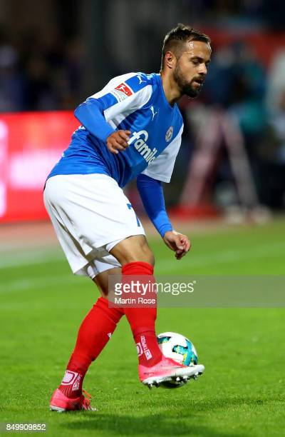 Rafael Czichos of Kiel runs with the ball during the Second Bundesliga match between Holstein Kiel and FC St Pauli at HolsteinStadion on September 19...
