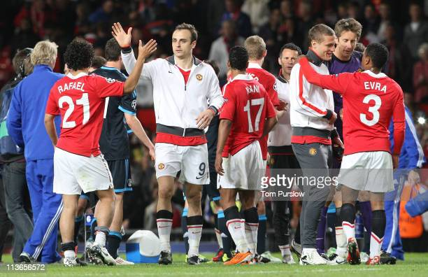Rafael Da Silva and Dimitar Berbatov of Manchester United celebrate after the UEFA Champions League SemiFinal second leg match between Manchester...