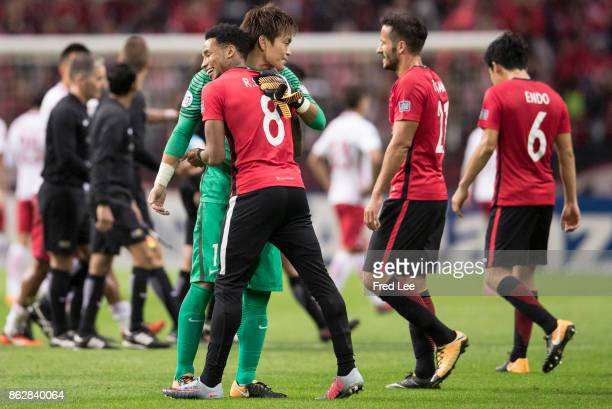 Rafael Da Silva and Nishikawa Shusaku of Urawa Red Diamonds celebrates a point during the AFC Champions League semi final second leg match between...
