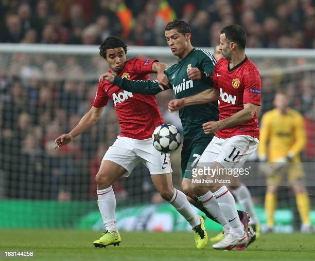 Rafael da Silva and Ryan Giggs of Manchester United in action with Cristiano Ronaldo of Real Madrid durign the UEFA Champions League match between...