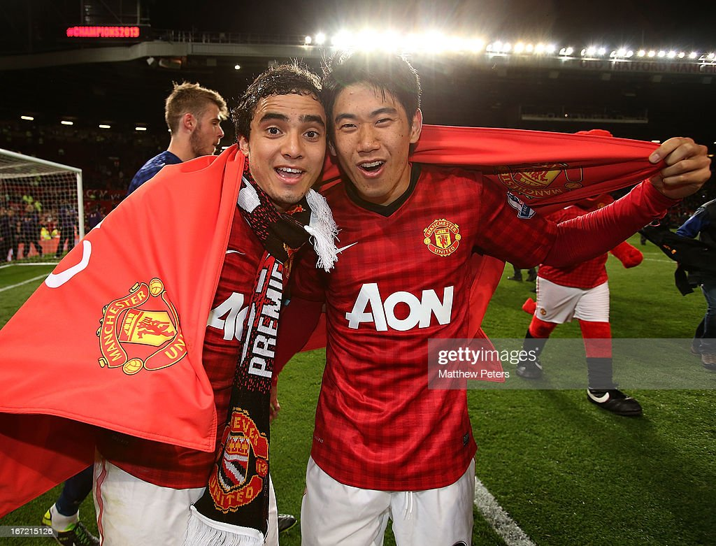 Rafael da Silva and <a gi-track='captionPersonalityLinkClicked' href=/galleries/search?phrase=Shinji+Kagawa&family=editorial&specificpeople=4314029 ng-click='$event.stopPropagation()'>Shinji Kagawa</a> of Manchester United celebrate after the Barclays Premier League match between Manchester United and Aston Villa at Old Trafford on April 22, 2013 in Manchester, England.