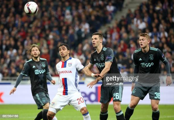Rafael da Silva of Lyon Nick Viergever and Matthijs de Ligt of Ajax Amsterdam during the UEFA Europa League semi final second leg match between...