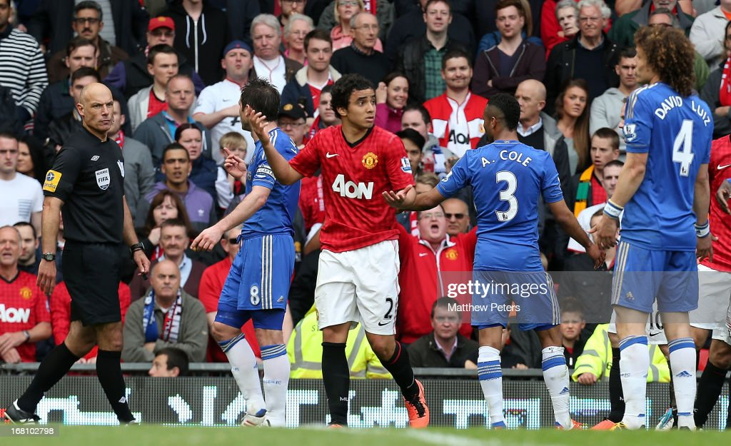 Rafael da Silva of Manchester United argues with David Luiz of Chelsea after being sent off during the Barclays Premier League match between Manchester United and Chelsea at Old Trafford on May 5, 2013 in Manchester, England.