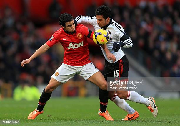 Rafael Da Silva of Manchester United battles with Kieran Richardson of Fulham during the Barclays Premier League between Manchester United and Fulham...