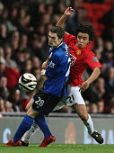 Rafael Da Silva of Manchester United clashes with Andrew Taylor of Middlesbrough during the Carling Cup third round match between Manchester United...