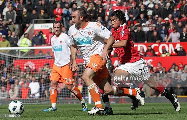 Rafael Da Silva of Manchester United clashes with Gary TaylorFletcher of Blackpool during the Barclays Premier League match between Manchester United...