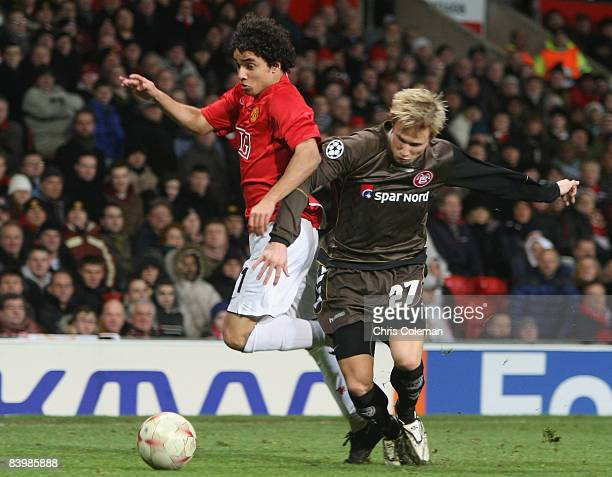 Rafael Da Silva of Manchester United clashes with Patrick Kristensen of Aalborg during the UEFA Champions League Group E match between Manchester...