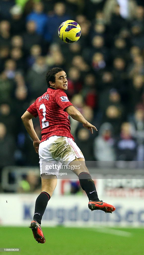 Rafael Da Silva of Manchester United heads the ball during the Barclays Premier League match between Wigan Athletic and Manchester United at the DW Stadium on January 1, 2013 in Wigan, England.