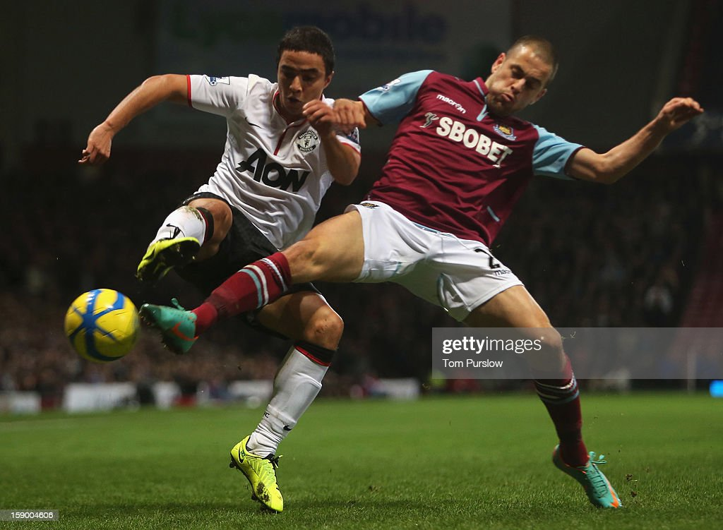 Rafael da Silva of Manchester United in action with <a gi-track='captionPersonalityLinkClicked' href=/galleries/search?phrase=Joe+Cole&family=editorial&specificpeople=171525 ng-click='$event.stopPropagation()'>Joe Cole</a> of West Ham United during the FA Cup Third Round match between West Ham United and Manchester United at Boleyn Ground on January 5, 2013 in London, England.