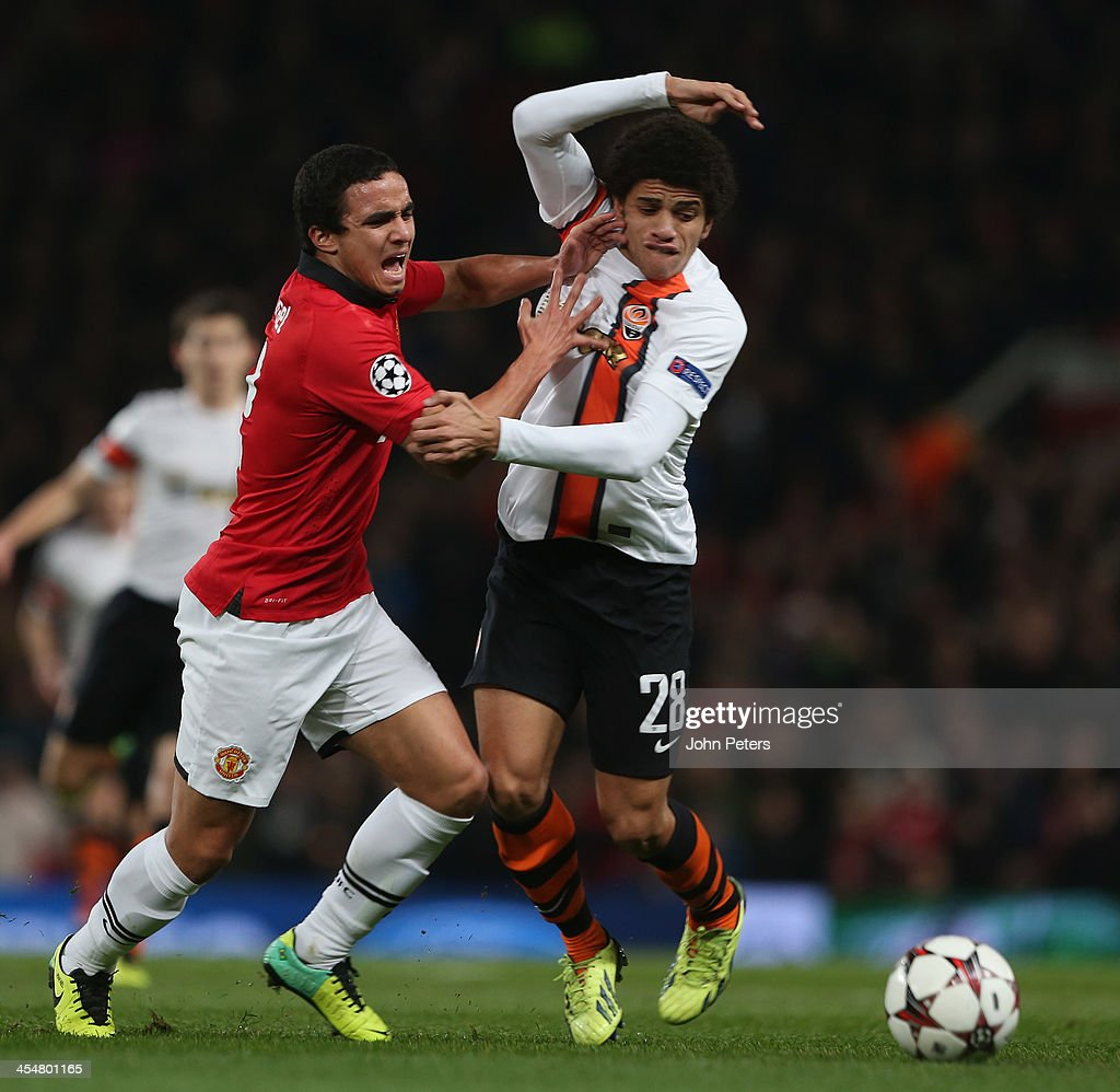 Rafael da Silva of Manchester United in action with <a gi-track='captionPersonalityLinkClicked' href=/galleries/search?phrase=Taison&family=editorial&specificpeople=5613080 ng-click='$event.stopPropagation()'>Taison</a> of Shakhtar Donetsk during the UEFA Champions League Group A match between Manchester United and Shakhtar Donetsk at Old Trafford on December 10, 2013 in Manchester, England.