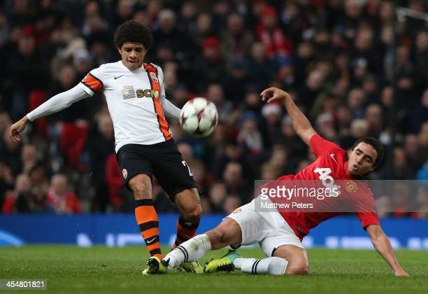Rafael da Silva of Manchester United in action with Taison of Shakhtar Donetsk during the UEFA Champions League Group A match between Manchester...