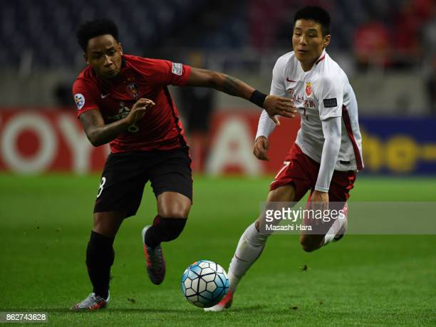 Rafael Da Silva of Urawa Red Diamonds and Wu Lei of Shanghai SIPG compete for the ball during the AFC Champions League semi final second leg match...