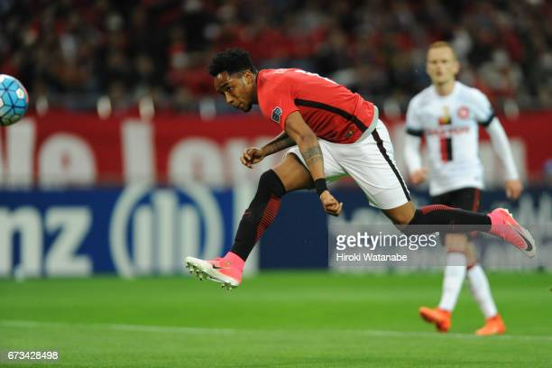 Rafael da Silva of Urawa Red Diamonds scores his team`s fifth goal during the AFC Champions League Group F match between Urawa Red Diamonds and...