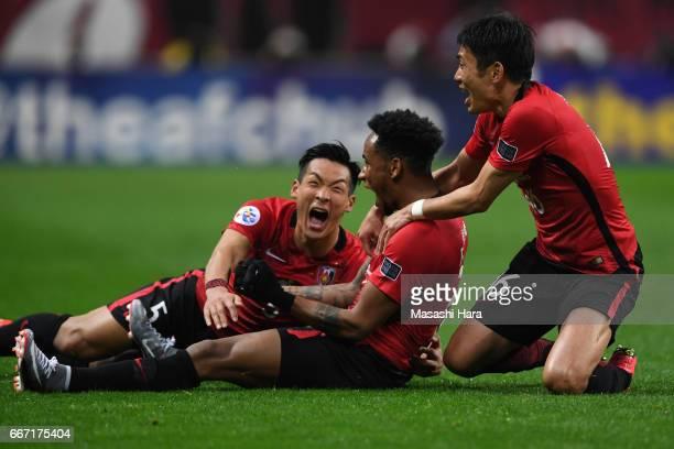 Rafael da Silva Ryota Moriwaki and Tomoaki Makino of Urawa Red Diamonds celebrate the first goal during the AFC Champions League Group F match...