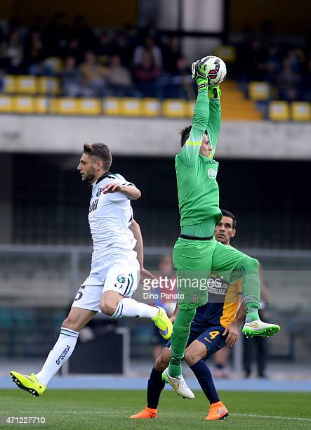 Rafael De Andrade goalkeeper of Hellas Verona competes with Domenico Berardi of US Sassuolo during the Serie A match between Hellas Verona FC and US...