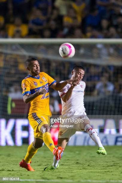 Rafael De Souza of Tigres fights for the ball with Jesus Mendez of Toluca during the 14th round match between Tigres UANL and Toluca as part of the...