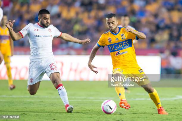 Rafael De Souza of Tigres fights for the ball with Pedro Canelo of Toluca during the 14th round match between Tigres UANL and Toluca as part of the...