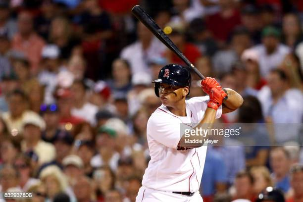 Rafael Devers of the Boston Red Sox at bat during the second inning against the St Louis Cardinals at Fenway Park on August 16 2017 in Boston...