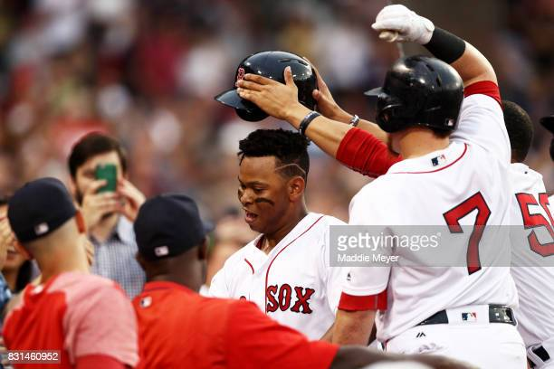 Rafael Devers of the Boston Red Sox celebrates with teammates after hitting his second home run during the fourth inning Cleveland Indians at Fenway...