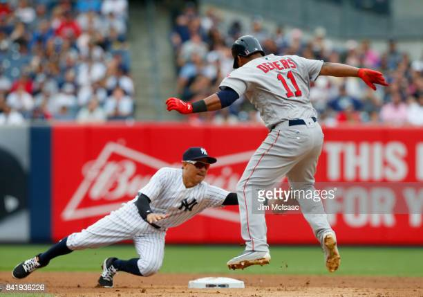 Rafael Devers of the Boston Red Sox is caught stealing second base in the fifth inning by Ronald Torreyes of the New York Yankees at Yankee Stadium...