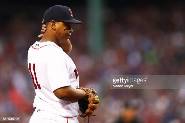 Rafael Devers of the Boston Red Sox looks on during the second inning against the St Louis Cardinals at Fenway Park on August 16 2017 in Boston...