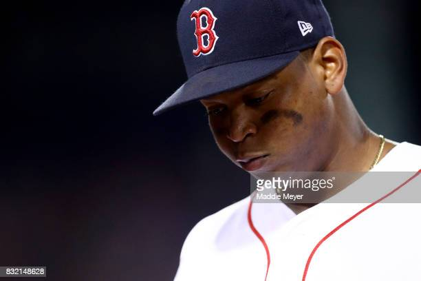 Rafael Devers of the Boston Red Sox looks on during the seventh inning at Fenway Park on August 15 2017 in Boston Massachusetts
