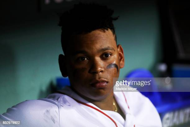 Rafael Devers of the Boston Red Sox looks on from the dugout during the fifth inning against the St Louis Cardinals at Fenway Park on August 16 2017...