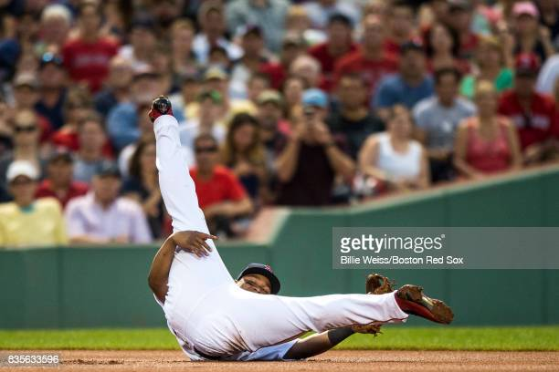 Rafael Devers of the Boston Red Sox reacts after making a diving stop during the inning of a game against the New York Yankees on August 19 2017 at...