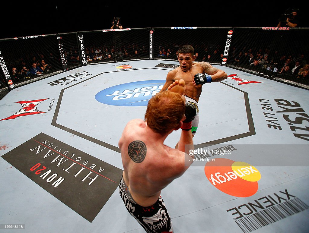 Rafael dos Anjos attempts to land a kick against <a gi-track='captionPersonalityLinkClicked' href=/galleries/search?phrase=Mark+Bocek&family=editorial&specificpeople=6871276 ng-click='$event.stopPropagation()'>Mark Bocek</a> in their lightweight bout during UFC 154 on November 17, 2012 at the Bell Centre in Montreal, Canada.