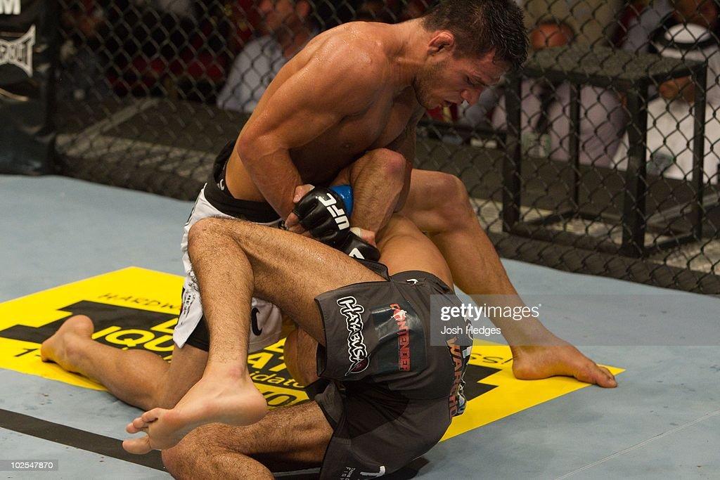 Rafael dos Anjos (white shorts) def. Terry Etim (grey shorts) - Submission (arm bar) - 4:30 round 2 during UFC 112 at Yas Island on April 10, 2010 in Abu Dhabi, United Arab Emirates.