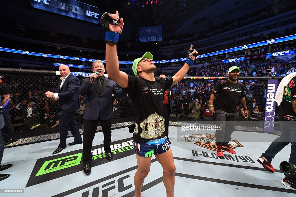 Rafael dos Anjos of Brazil celebrates after being announced the new UFC Lightweight Champion after defeating Anthony Pettis in their UFC lightweight championship bout during the UFC 185 event at the American Airlines Center on March 14, 2015 in Dallas, Texas.