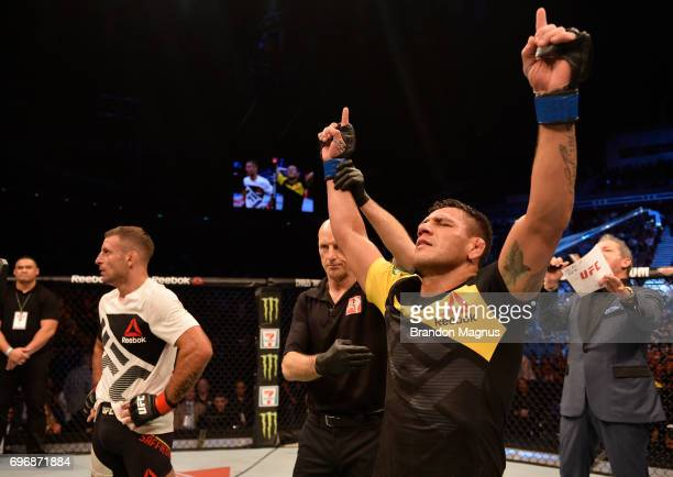 Rafael Dos Anjos of Brazil celebrates after his decision victory over Tarec Saffiedine of Belgium in their welterweight bout during the UFC Fight...