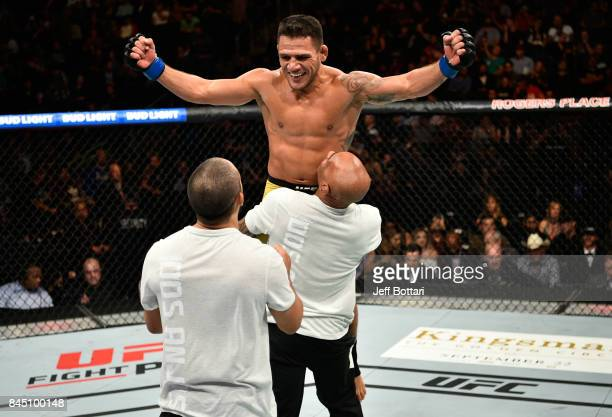 Rafael Dos Anjos of Brazil celebrates his submission victory over Neil Magny in their welterweight bout during the UFC 215 event inside the Rogers...