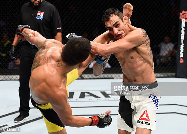 Rafael Dos Anjos of Brazil kicks Tony Ferguson of the United States in their lightweight bout during the UFC Fight Night event at Arena Ciudad de...