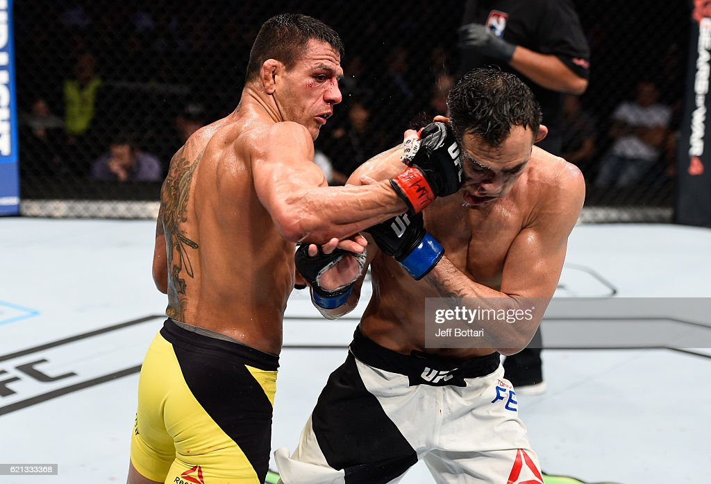 Rafael Dos Anjos of Brazil punches Tony Ferguson of the United States in their lightweight bout during the UFC Fight Night event at Arena Ciudad de Mexico on November 5, 2016 in Mexico City, Mexico.