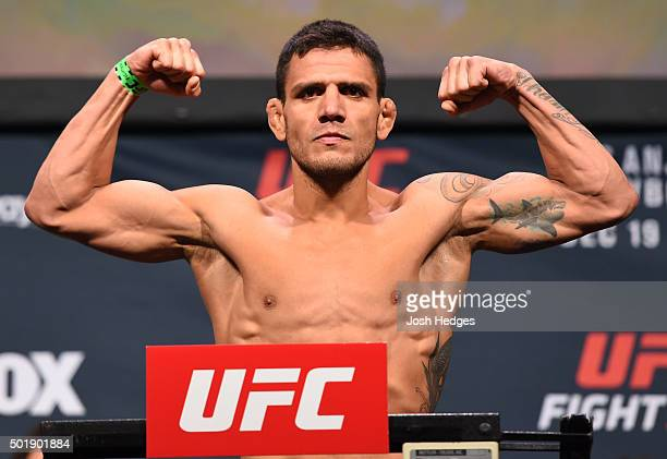 Rafael dos Anjos of Brazil weighs in during the UFC weighin at the Orange County Convention Center on December 18 2015 in Orlando Florida