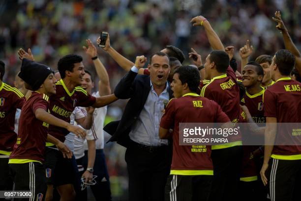 Rafael Dudamel coach of the Venezuelan Under20 national team runnerup at the U20 World Cup in South Korea and the players celebrate and acknowledge...