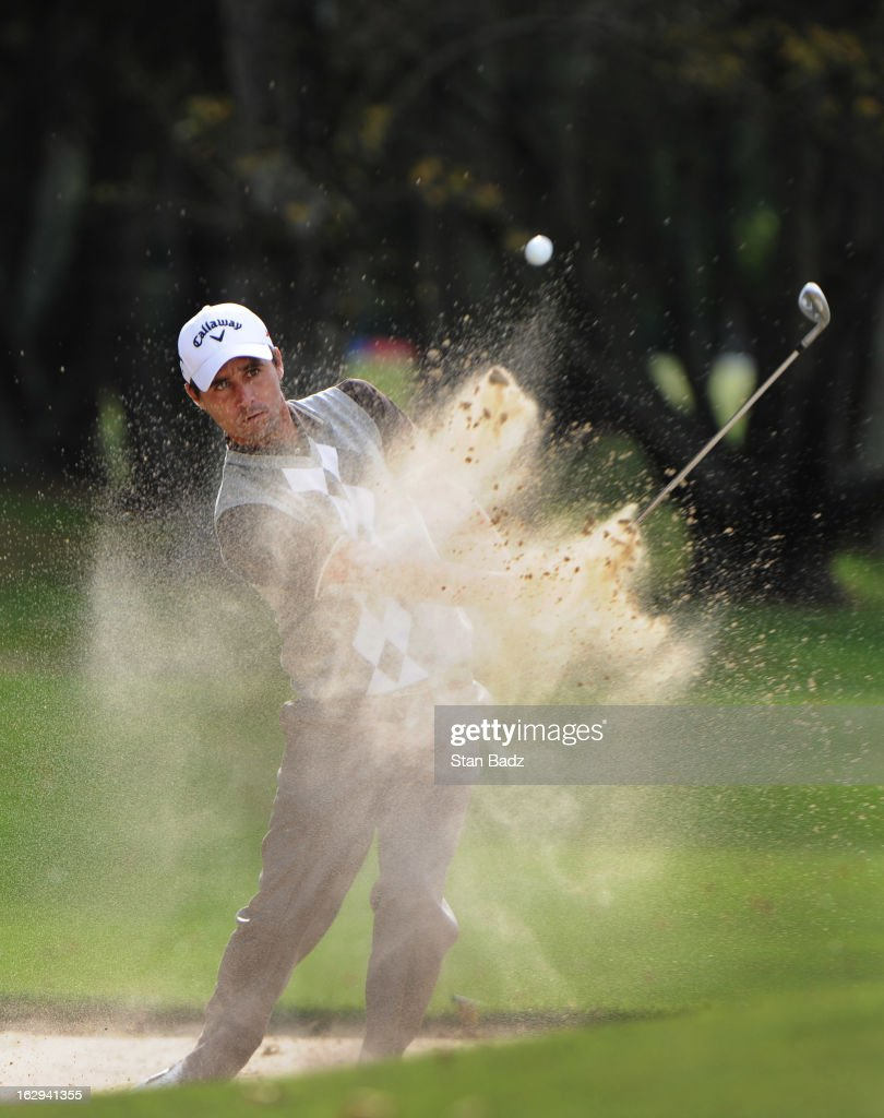 Rafael Echenique of Argentina hits from a bunker on the ninth hole during the second round of the Colombia Championship at Country Club de Bogota on March 1, 2013 in Bogota, Colombia.