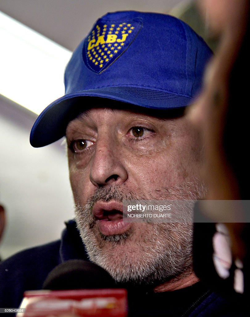 Rafael Elias, one of the ringleaders of the Boca Juniors fans gang arrested for alleged hooliganism speaks with journalists in Asuncion, on April 29, 2016. 237 Boca Juniors fans fans where arrested on charges of vandalism at the end of the Boca Juniors vs Cerro Porteno Libertadores Cup match on the eve. / AFP / NORBERTO