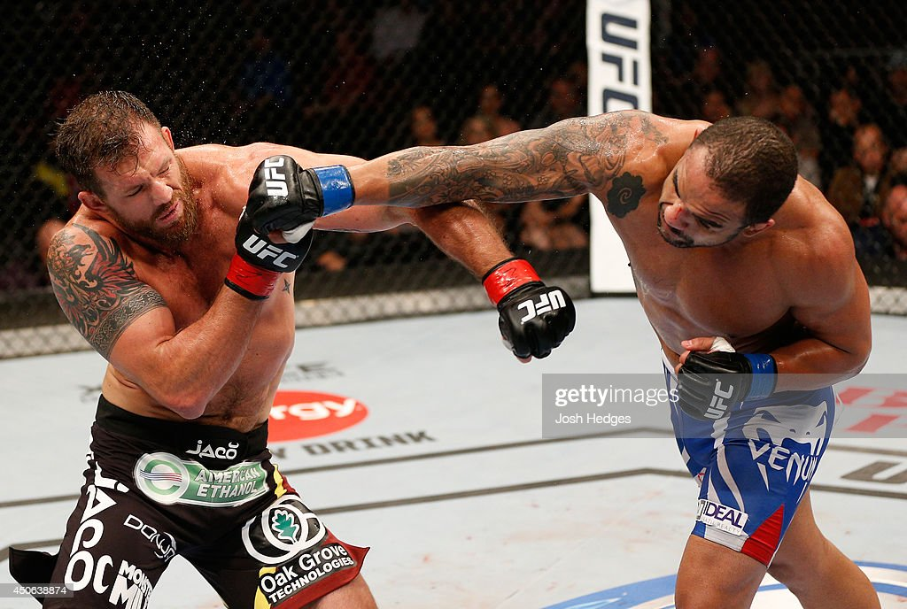 Rafael 'Feijao' Cavalcante punches Ryan Bader in their light heavyweight bout at Rogers Arena on June 14, 2014 in Vancouver, Canada.