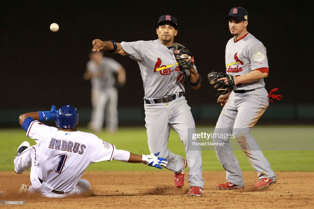 Rafael Furcal of the St Louis Cardinals turns the double play as Elvis Andrus of the Texas Rangers slides into second base in the sixth inning during...