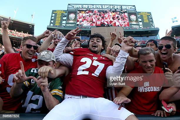 Rafael Gaglianone of the Wisconsin Badgers celebrates with fans after beating the LSU Tigers 1614 at Lambeau Field on September 3 2016 in Green Bay...