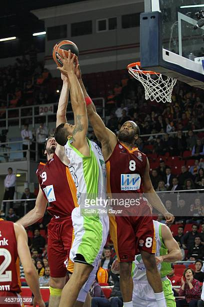 Rafael Hettsheimeir of Unicaja Malaga competes with Malik Hairston of Galatasaray Liv Hospital during the 20132014 Turkish Airlines Euroleague...