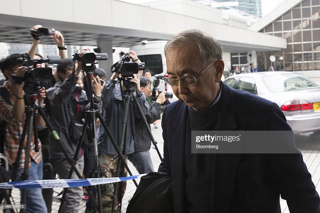 Rafael Hui, Hong Kong's former chief secretary, arrives at the High Court in Hong Kong, China, on Thursday, May 8, 2014. Thomas and Raymond Kwok, the billionaire brothers running Hong Kongs second-largest developer, are set to go on trial today for bribing Hui, the Chinese citys former No. 2 official. All three men have pleaded not guilty and denied all charges. Photographer: Brent Lewin/Bloomberg via Getty Images