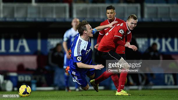 Rafael Kazior of Holstein Kiel is brought down by Julian Grupp of SV WehenWiesbaden during the 3 Liga match between SV WehenWiesbaden and Holstein...