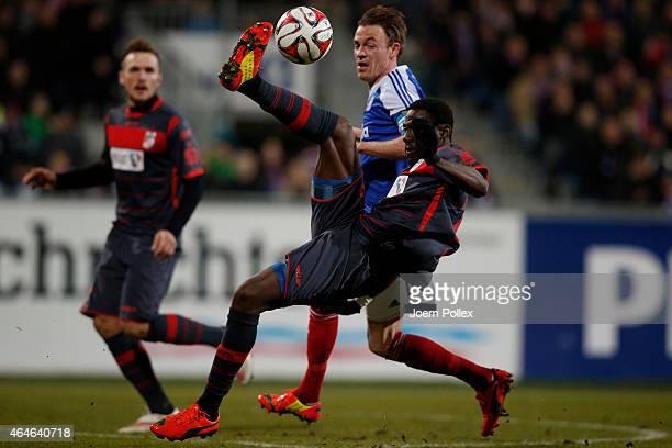 Rafael Kazior of Kiel and Steve Gohouri of Erfurt compete the ball during the Third League match between Holstein Kiel and RW Erfurt at...