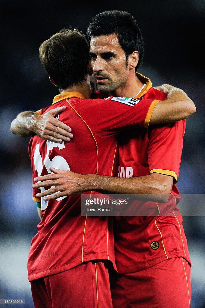 Rafael Lopez and his team-mate Juan Rodriguez of Getafe CF celebrate after defeating RCD Espanyol at the end of the La Liga match between RCD Espanyol and Getafe CF at Cornella-El Prat Stadium on September 29, 2013 in Barcelona, Spain.