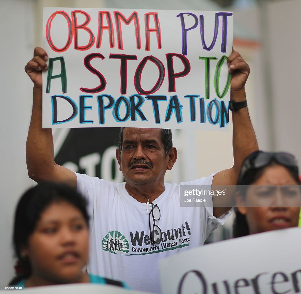 Rafael Lucas holds a sign reading 'Obama Put a Stop to Deportation' as he and others participate in a rally calling on President Barack Obama to immediately suspend deportations and for Congress to pass an immigration reform that's inclusive of all 11 million undocumented people in the U.S. on May 11, 2013 in Homestead, Florida. The rally is part of what is being called a rolling fast in different places throughout the nation over the course of the next two months to bring what organizers say is a moral, prophetic voice to the immigration debate.
